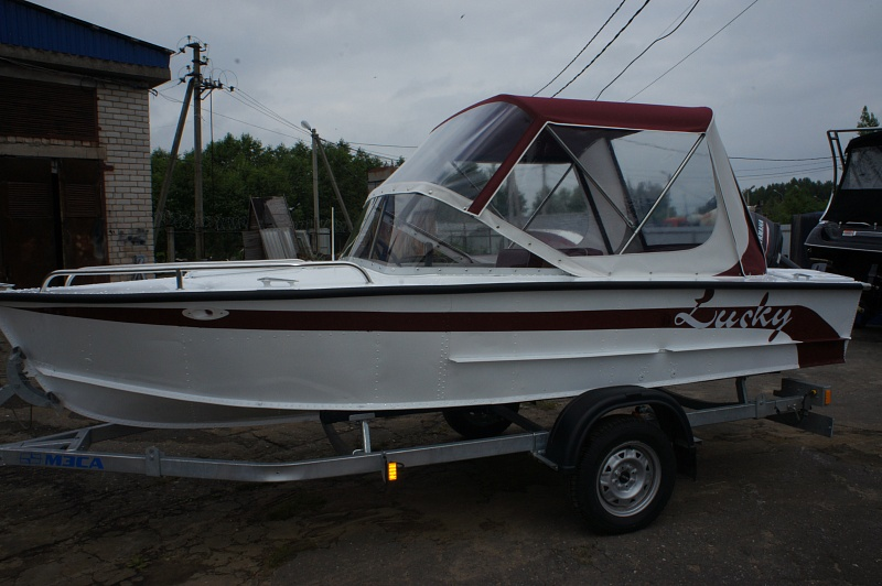 Ходовой тент на лодку и катер цена в компании «МаринЛайн». Ссылка на фотографию: http://marinline.ru/uploads/posts/2018-06/1528915638_hodovyie-tentyi-na-kater-hodovoy-tent-76.jpg
