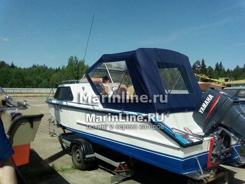 Ходовой тент на лодку и катер цена в компании «МаринЛайн». Ссылка на фотографию: http://marinline.ru/uploads/posts/2018-06/1528915659_hodovyie-tentyi-na-kater-hodovoy-tent-7.jpg