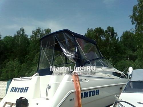 Ходовой тент на лодку и катер цена в компании «МаринЛайн». Ссылка на фотографию: http://marinline.ru/uploads/posts/2018-06/1528915663_hodovyie-tentyi-na-kater-hodovoy-tent-14.jpg