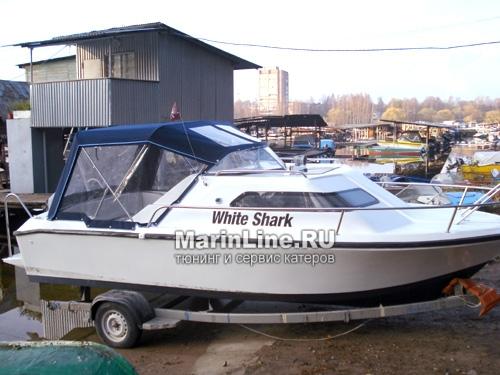 Ходовой тент на лодку и катер цена в компании «МаринЛайн». Ссылка на фотографию: http://marinline.ru/uploads/posts/2018-06/1528915669_hodovyie-tentyi-na-kater-hodovoy-tent-23.jpg