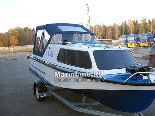 Ходовой тент на лодку и катер цена в компании «МаринЛайн». Ссылка на фотографию: http://marinline.ru/uploads/posts/2018-06/1528915702_hodovyie-tentyi-na-kater-hodovoy-tent-25.jpg